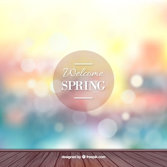 Spring bokeh background in blue, red and yellow tones