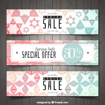 Spring sale banners with geometric shapes