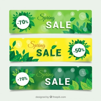 Spring sale banners with green leaves