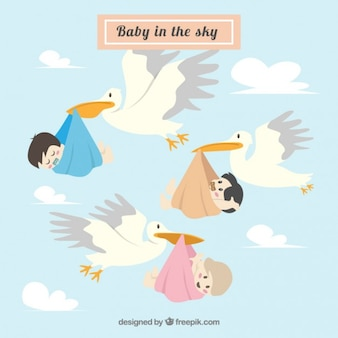 Storks with lovely babies in the sky