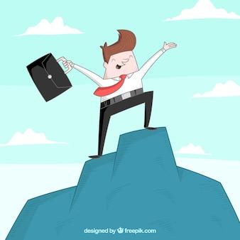 Successful businessman on a mountain