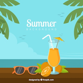 Summer background with orange drink and palm trees