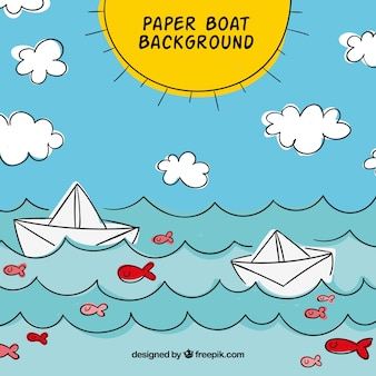 Summer background with paper boats in the sea