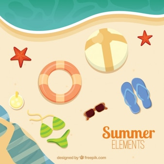 Summer elements on the beach in top view