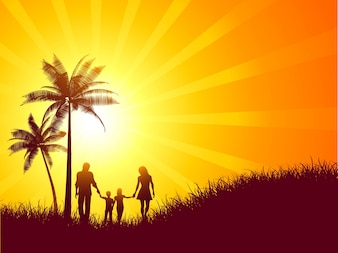 Summer landscape with silhouette of a family walking