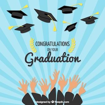 Sunburst background with hands and graduation caps