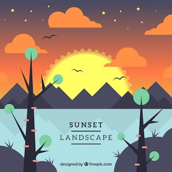 Sunset background with trees and mountains in flat design