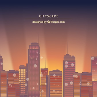 Sunset modern city background with bokeh effect