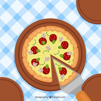 Tablecloth background with delicious pizza