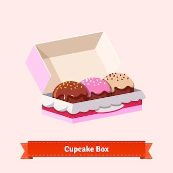 Tasty looking cupcakes in the cardbox