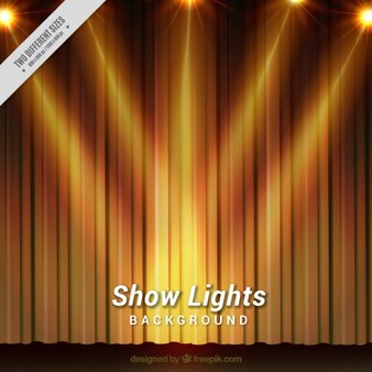 Theater background with golden curtains and several spotlights