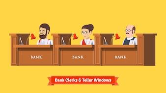 Three bank clerks at work