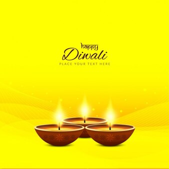 Three candles for diwali on a bright yellow background
