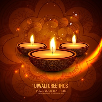 Three candles on an orange abstract background for diwali