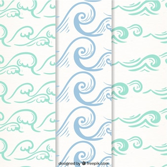 Three decorative patterns with hand-drawn waves