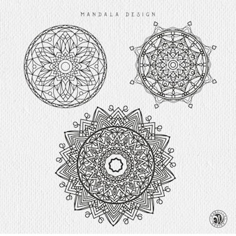 Three hand drawn mandalas