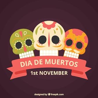Three mexican skulls background