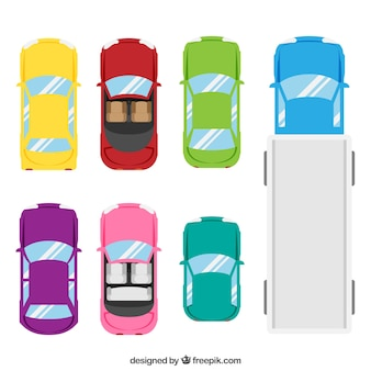 Top view of six cars and a truck