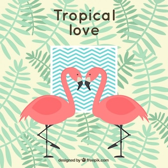 Tropical background with flamingos and palm leaves