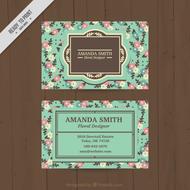Turquoise business card with flowers