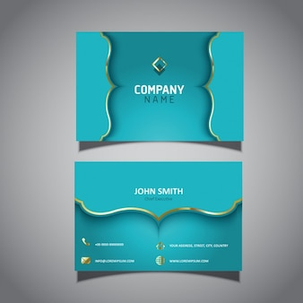 Turquoise business card with golden ornaments