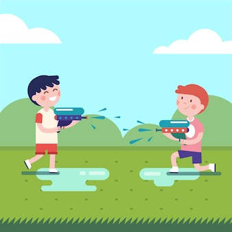 Two boys playing water guns wars