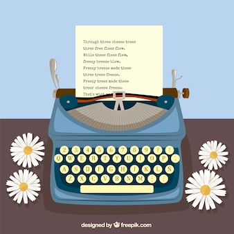 Typewriter and daisies