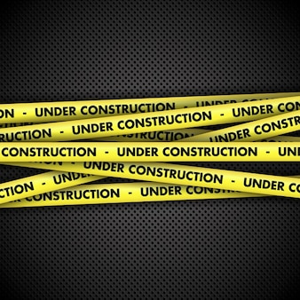 Under construction warning tape metal background