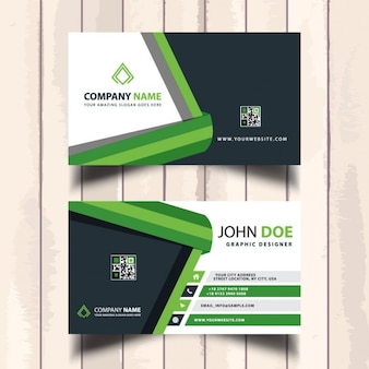 Useful green business card with polygonal shapes