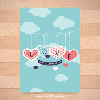 Valentine's day card with hearts hanging