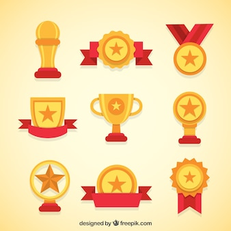 Variety of golden trophies and medals