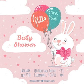 Vintage baby shower invitation with rabbit and balloons