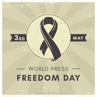 Vintage background with black ribbon for world press freedom day