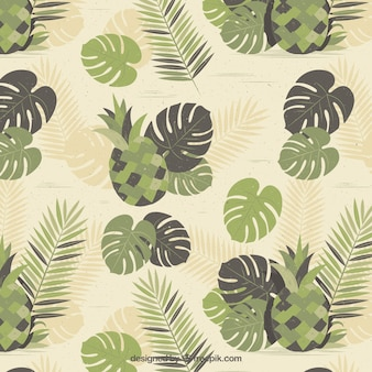 Vintage background with pineapples and leaves in green tones