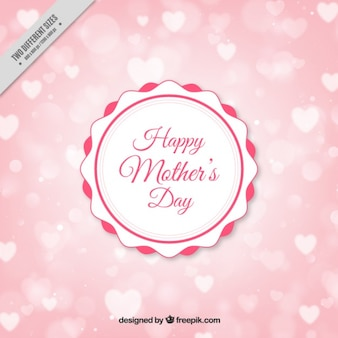 Vintage badge of mother's day on a hearts background