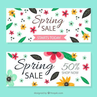 Vintage banners of spring sales with leaves and flowers