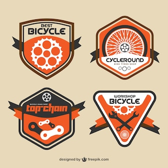 Vintage bike badges in flat design and orange color