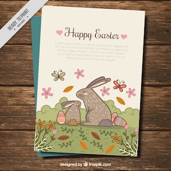 Vintage card of easter bunnies in a landscape