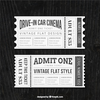 Vintage cinema tickets in grey and white colors