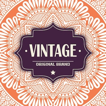 Vintage label on an orange mandala