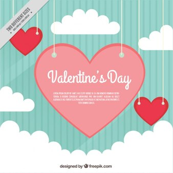 Vintage striped background and hearts between clouds