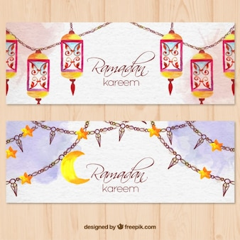 Watercolor ramadan banners with lantern and garlands