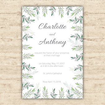 Watercolor wedding invitation template with green leaves