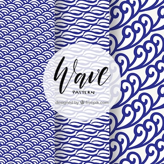 Wave patterns with dark blue shapes