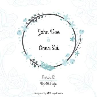 Wedding card with a floral wreath