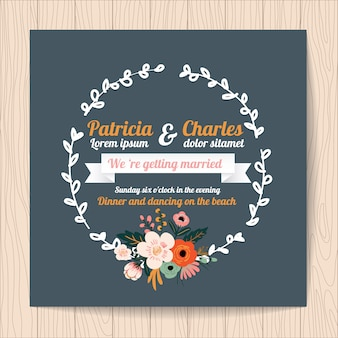 Wedding invitation with ribbon and floral wreath