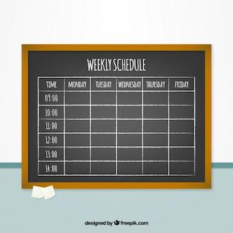 Weekly schedule on a blackboard