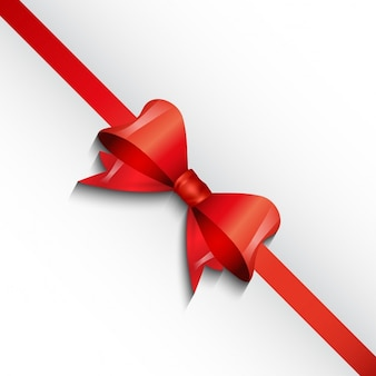 White background with a red bow