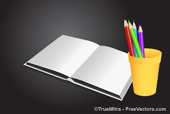 White book with colored pencils