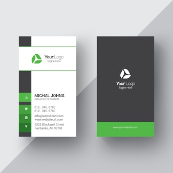 White business card with black and green details